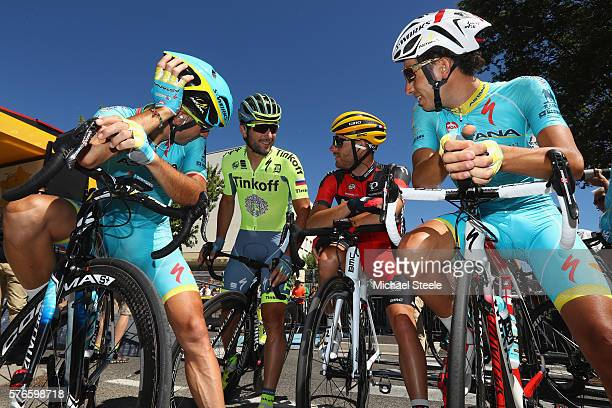 Vincenzo Nibali of Italy and team mate Fabio Aru of Italy and Astana Pro Team talk with Damiano Caruso of Italy and BMC Racing Team and Oscar Gatto...