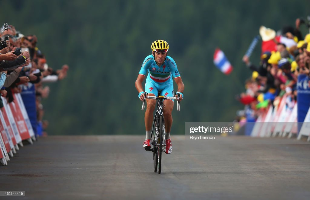 <a gi-track='captionPersonalityLinkClicked' href=/galleries/search?phrase=Vincenzo+Nibali&family=editorial&specificpeople=770634 ng-click='$event.stopPropagation()'>Vincenzo Nibali</a> of Italy and the Astana Pro Team celebrates crossing the finish line to win the tenth stage of the 2014 Tour de France, a 162km stage between Mulhouse and La Planche des Belles Filles, on July 14, 2014 at La Planche des Belles Filles, France.