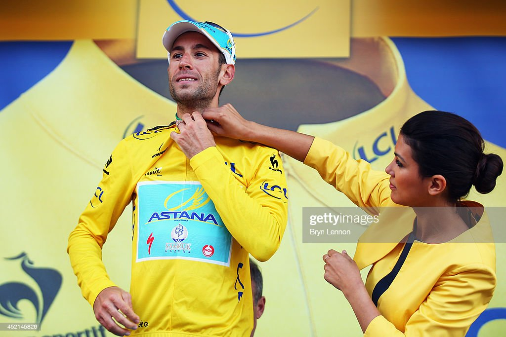 <a gi-track='captionPersonalityLinkClicked' href=/galleries/search?phrase=Vincenzo+Nibali&family=editorial&specificpeople=770634 ng-click='$event.stopPropagation()'>Vincenzo Nibali</a> of Italy and the Astana Pro Team celebrates on the podium as he regains the overall race leader's yellow jersey after the tenth stage of the 2014 Tour de France, a 162km stage between Mulhouse and La Planche des Belles Filles, on July 14, 2014 at La Planche des Belles Filles, France.