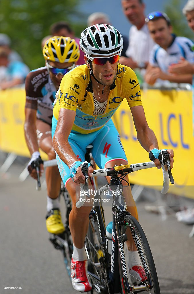 <a gi-track='captionPersonalityLinkClicked' href=/galleries/search?phrase=Vincenzo+Nibali&family=editorial&specificpeople=770634 ng-click='$event.stopPropagation()'>Vincenzo Nibali</a> of Italy and the Astana Pro Team defends the overall race leader's yellow jersey as he leads <a gi-track='captionPersonalityLinkClicked' href=/galleries/search?phrase=Jean-Christophe+Peraud&family=editorial&specificpeople=777897 ng-click='$event.stopPropagation()'>Jean-Christophe Peraud</a> of France and AG2R La Mondiale on the climb to the finish during the fourteenth stage of the 2014 Tour de France, a 177km stage between Grenoble and Risoul, on July 19, 2014 in Risoul, France.