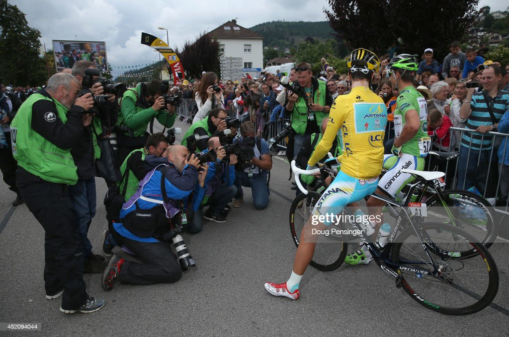 Vincenzo Nibali of Italy and the Astana Pro Team in the overall race leader's yellow jersey and Peter Sagan of Slovakia and Cannondale in the points leader's green jersey are the subject of the photographers prior to the start of stage nine of the 2014 Le Tour de France from Gerardmer to Mulhouse on July 13, 2014 in Gerardmer, France.