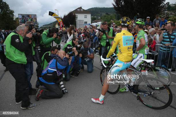 Vincenzo Nibali of Italy and the Astana Pro Team in the overall race leader's yellow jersey and Peter Sagan of Slovakia and Cannondale in the points...