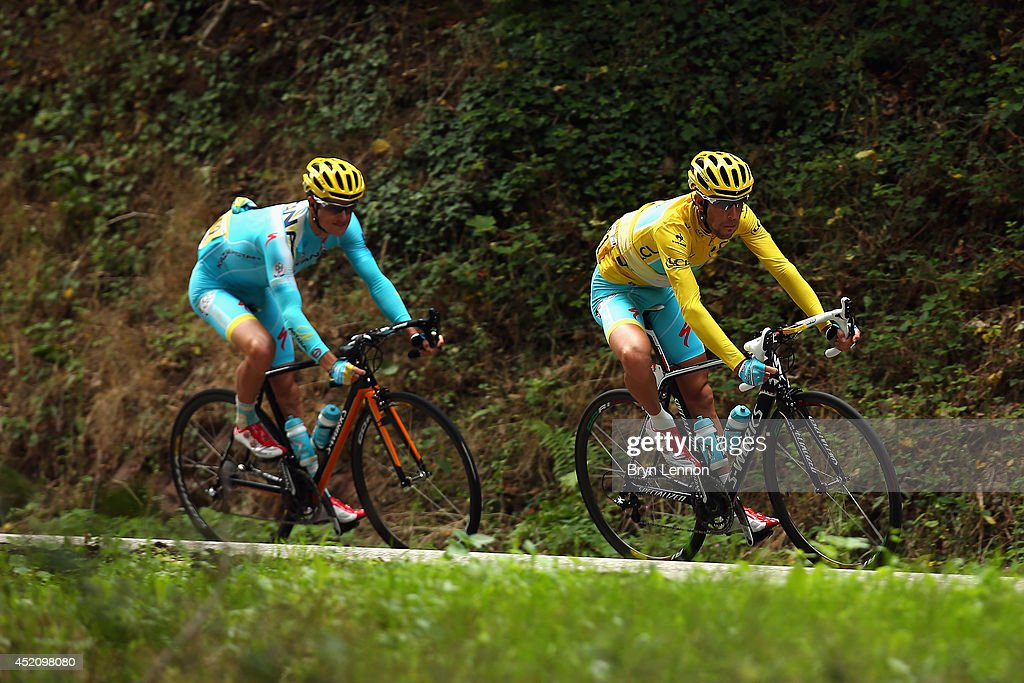 Vincenzo Nibali of Italy and the Astana Pro Team (R) is followed by teammate Jakob Fugslang of Denmark during the ninth stage of the 2014 Tour de France, a 170km stage between Gerardmer and Mulhouse, on July 13, 2014 in Mulhouse, France.