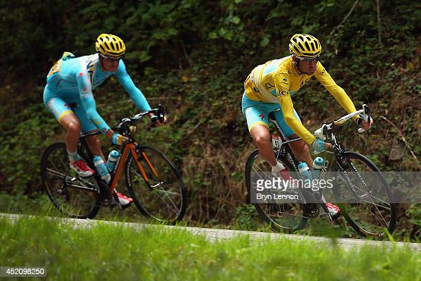 Vincenzo Nibali of Italy and the Astana Pro Team is followed by teammate Jakob Fugslang of Denmark during the ninth stage of the 2014 Tour de France...