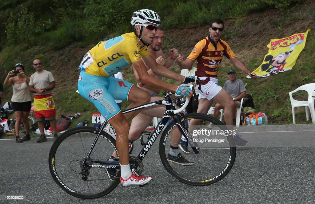 Vincenzo Nibali of Italy and the Astana Pro Team makes the climb to the finish in a solo attack as he defends the overall race leader's jersey with a victory in the eighteenth stage of the 2014 Tour de France, a 146km stage between Pau and Hautacam, on July 24, 2014 in Hautacam, France.