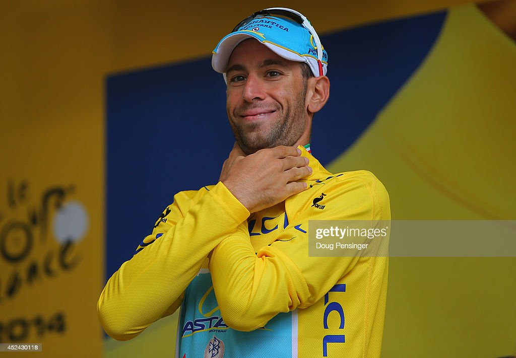 <a gi-track='captionPersonalityLinkClicked' href=/galleries/search?phrase=Vincenzo+Nibali&family=editorial&specificpeople=770634 ng-click='$event.stopPropagation()'>Vincenzo Nibali</a> of Italy and the Astana Pro Team takes the podium after defending the overall race leader's yellow jersey during the fifteenth stage of the 2014 Tour de France, a 222km stage between Tallard and Nimes, on July 20, 2014 in Nimes, France.