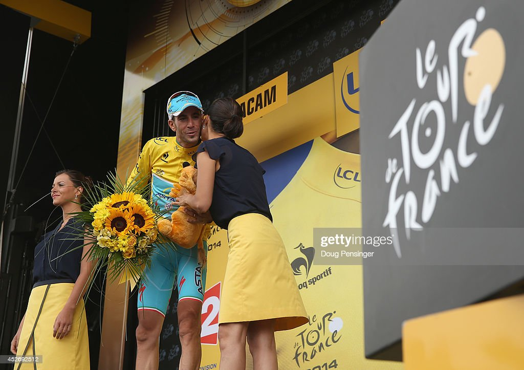 Vincenzo Nibali of Italy and the Astana Pro Team takes the podium after defending the overall race leader's jersey with his victory in the eighteenth stage of the 2014 Tour de France, a 146km stage between Pau and Hautacam, on July 24, 2014 in Hautacam, France.