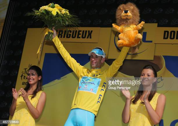 Vincenzo Nibali of Italy and the Astana Pro Team takes the podium after defending the overall race leader's jersey with a fourth place finish in the...