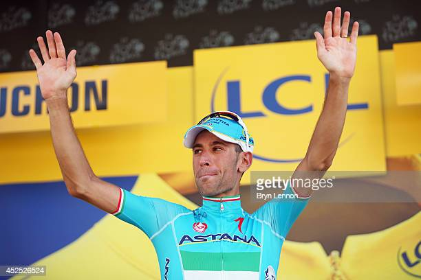 Vincenzo Nibali of Italy and the Astana team celebrates retaining his race leader's yellow jersey stage 16 of the 2014 Tour de France a 238km stage...