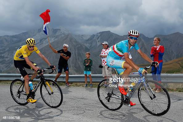 Vincenzo Nibali of Italy riding for Astana Pro Team attacks Chris Froome of Great Britain riding for Team Sky in the overall race leader yellow...
