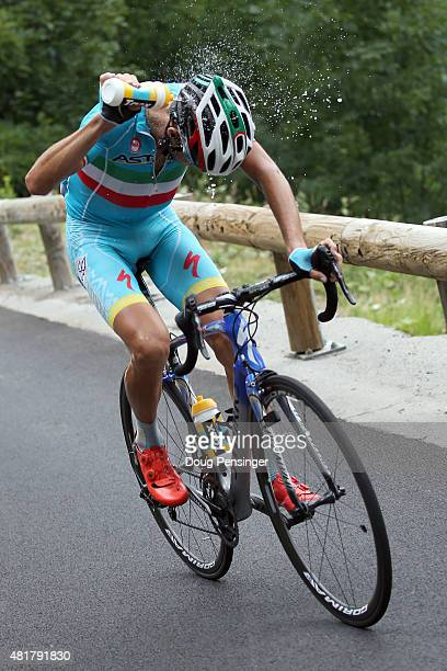 Vincenzo Nibali of Italy riding for Astana Pro Team douses himself with water as he races to victory in stage 19 of the 2015 Tour de France from...