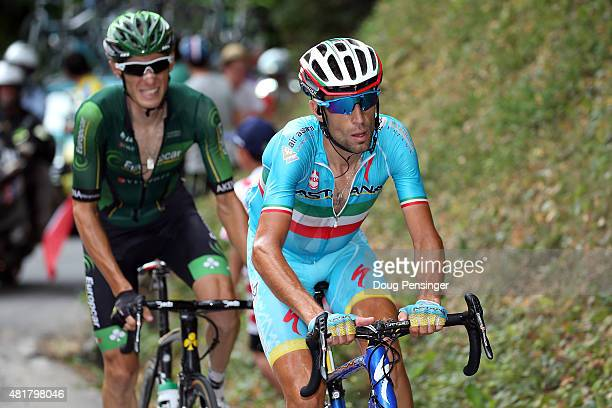 Vincenzo Nibali of Italy riding for Astana Pro Team passes Pierre Rolland of France riding for Team Europcar to move to the front of the race en...