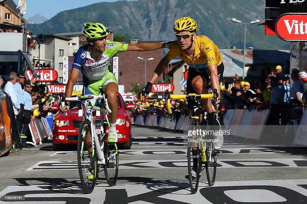 <a gi-track='captionPersonalityLinkClicked' href=/galleries/search?phrase=Vincenzo+Nibali&family=editorial&specificpeople=770634 ng-click='$event.stopPropagation()'>Vincenzo Nibali</a> of Italy riding for Liquigas-Cannondale crosses the finish line with <a gi-track='captionPersonalityLinkClicked' href=/galleries/search?phrase=Bradley+Wiggins&family=editorial&specificpeople=182490 ng-click='$event.stopPropagation()'>Bradley Wiggins</a> of Great Britain riding for Sky Procycling in the race leader's yellow jersey in stage eleven of the 2012 Tour de France from Albertville to La Toussuire on July 12, 2012 in La Toussuire, France. Wiggins defended the race leader's yellow jersey and Nibali passed Cadel Evans to move into the third place in the general classification.