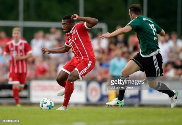 Vincenzo Potenza of Wolfratshausen and Franck Evina of Bayern fight for the ball during the preseason friendly match between BCF Wolfratshausen and...