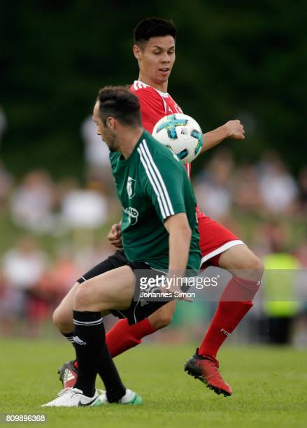 Vincenzo Potenza of Wolfratshausen and Raphael Obermair of Bayern fight for the ball during the preseason friendly match between BCF Wolfratshausen...