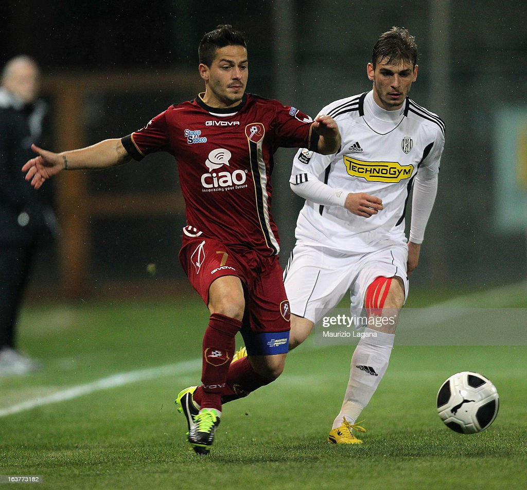 Vincenzo Sarno (L) of Reggina Calcio competes for the ball with Manuel Giandonato of AC Cesena during the Serie B match between Reggina Calcio and AC Cesena at Stadio Oreste Granillo on March 15, 2013 in Reggio Calabria, Italy.
