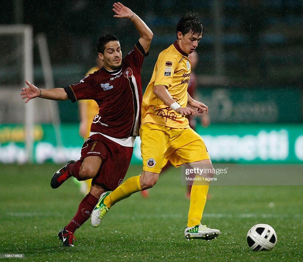 Vincenzo Sarno of Reggina competes for the ball with Danile Baselli of Cittadella during the Serie B match between Reggina Calcio and AS Cittadella...