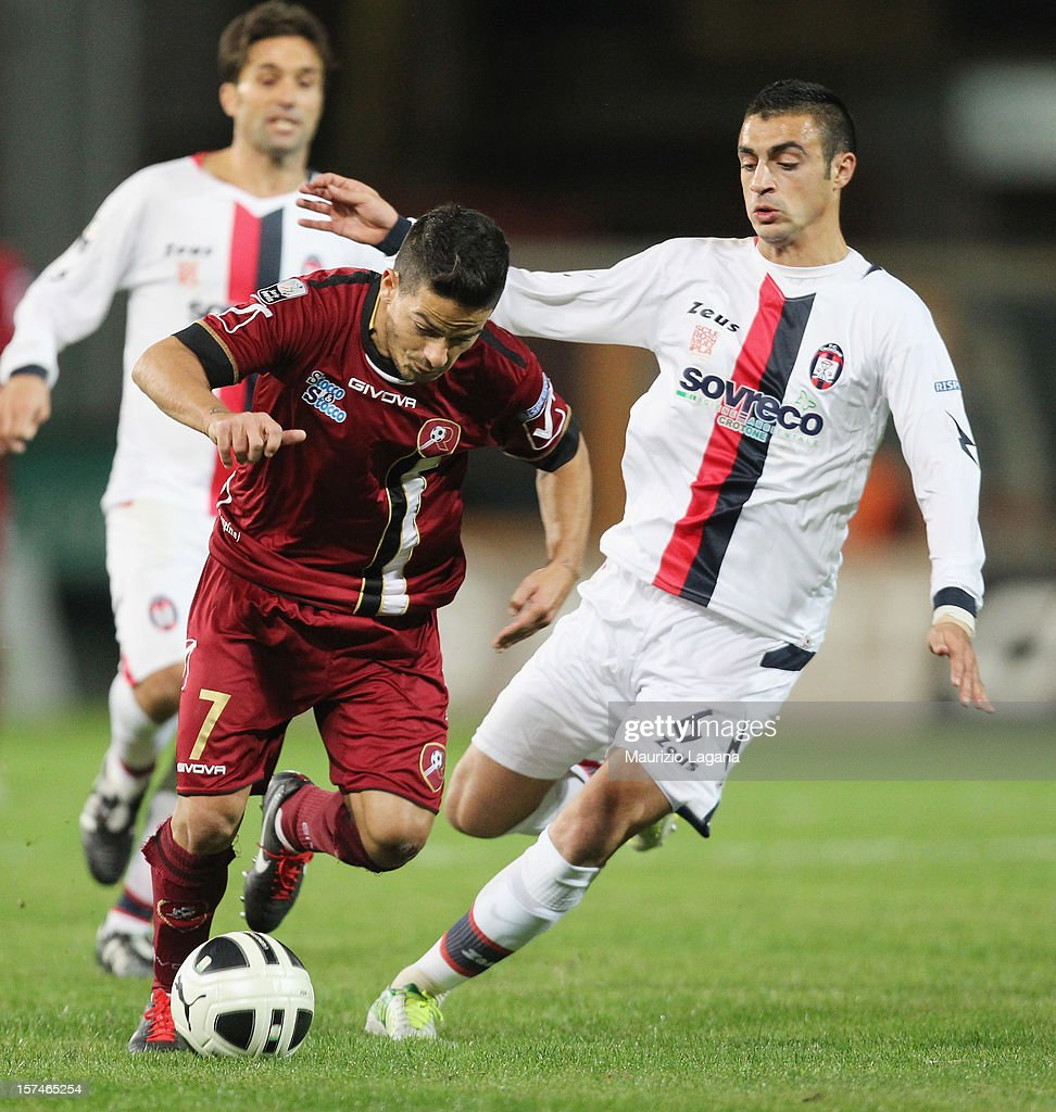 Vincenzo Sarno (L) of Reggina competes for the ball with Mirko Eramo of Crotone during the Serie B match between Reggina Calcio and FC Crotone at Stadio Oreste Granillo on December 3, 2012 in Reggio Calabria, Italy.