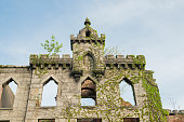 This is a royalty free stock color photograph of the ruins of an old smallpox hospital on Roosevelt Island in travel destination New York City, USA. Vines cover the facade. Photographed with a Nikon D