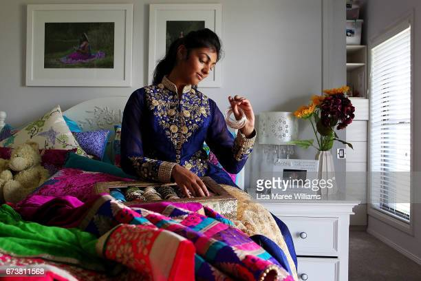 Vineesha Veer a Fijian Indian selects traditional jewellery to wear at her home on January 27 2017 in Tamworth Australia Tamworth is a large regional...