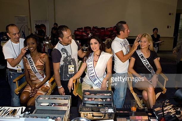 Vinicio Conti Lazaro Gonzalez and Alfonso Waithsman do the makeup of Jewel Garner Miss Barbados 2007 Nadine Njeim Miss Lebanon 2007 and Christa...