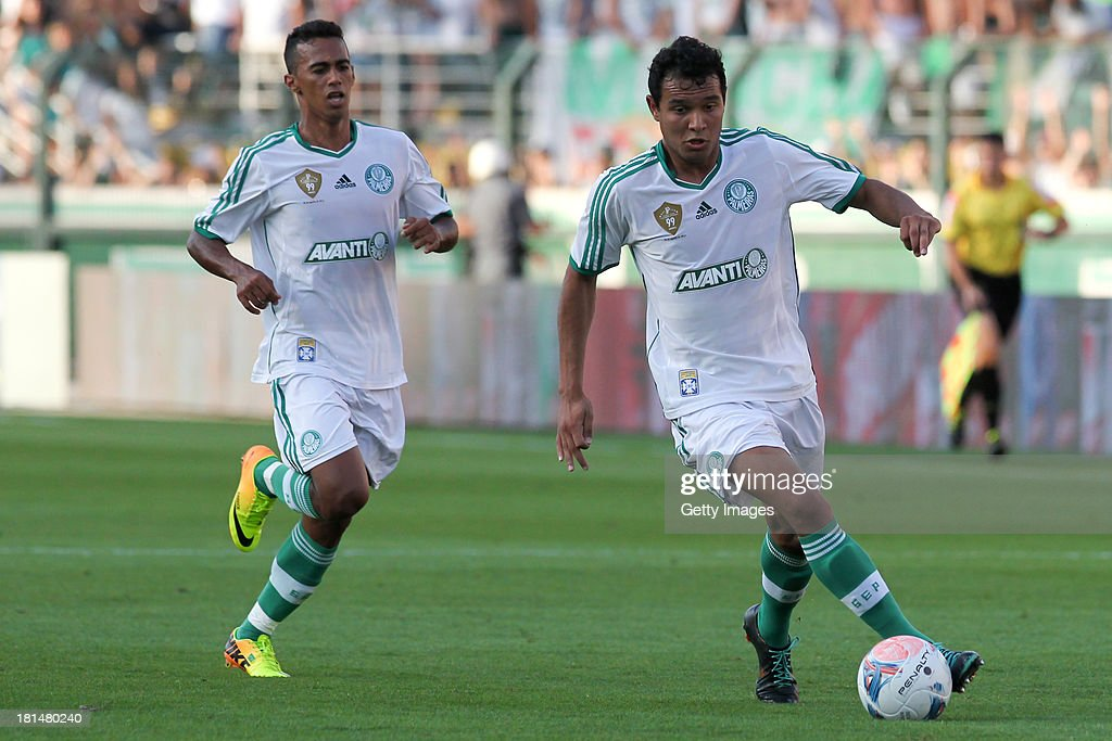 Vinicius, from Palmeiras, followed by a teammate, controls the ball during the match between Palmeiras and Sport for the Brazilian Series B 2013 at Pacaembu stadium on September 21, 2013 in Sao Paulo, Brazil.