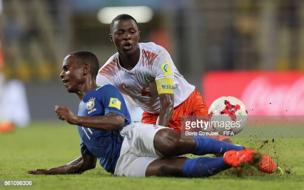 Vinicius Jr of Brazil is challenged by Nasser Mahaman of Niger during the FIFA U17 World Cup India 2017 group C match between Niger and Brazil at...