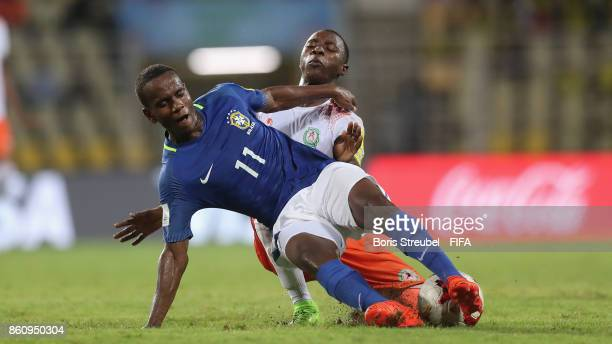 Vinicius Jr of Brazil is tackled by Nasser Mahaman of Niger during the FIFA U17 World Cup India 2017 group C match between Niger and Brazil at Pandit...
