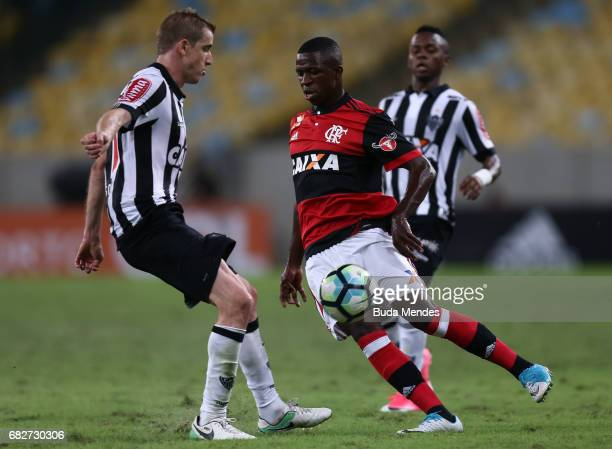 Vinicius Jr of Flamengo struggles for the ball with Adilson of Atletico MG during a match between Flamengo and Atletico MG part of Brasileirao Series...