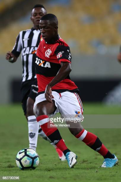 Vinicius Jr of Flamengo struggles for the ball with Cazares of Atletico MG during a match between Flamengo and Atletico MG part of Brasileirao Series...