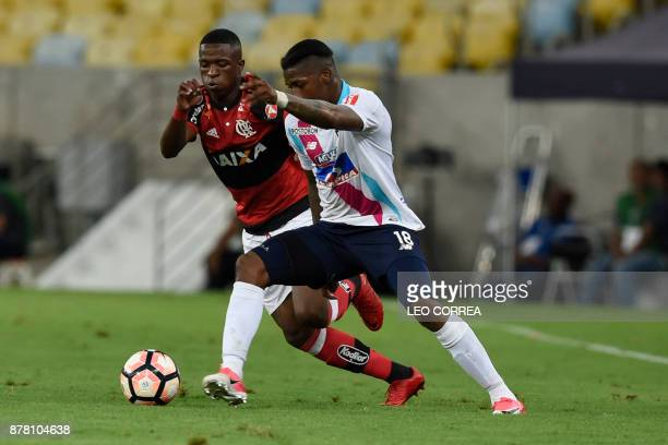 Vinicius Junior of Brazil's Flamengo fights for the ball with Yony Gonzalez of Colombia's Junior de Barranquilla during their Copa Sudamericana 1st...