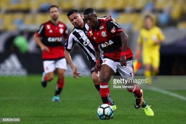 Vinicius Junior of Flamengo struggles for the ball with Rodrigo Lindoso of Botafogo during a match between Flamengo and Botafogo part of Copa do...