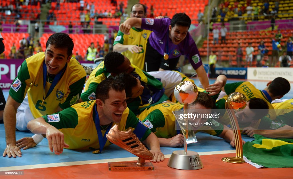 Vinicius of Brazil celebrates with team mates after winning the FIFA Futsal World Cup Final at Indoor Stadium Huamark on November 18, 2012 in Bangkok, Thailand.