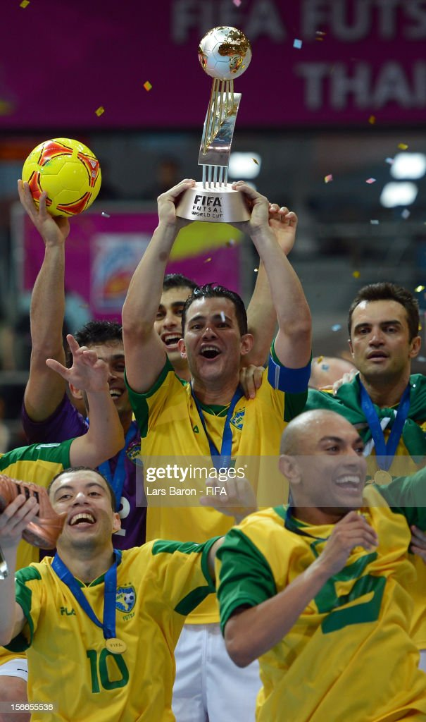 Vinicius of Brazil lifts the trophy after winning the FIFA Futsal World Cup Final at Indoor Stadium Huamark on November 18 2012 in Bangkok Thailand