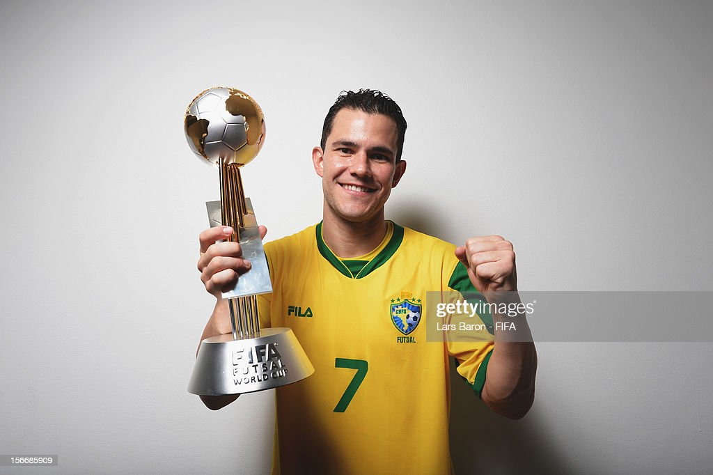 Vinicius of Brazil poses with the trophy in the locker room after winning the FIFA Futsal World Cup Final at Indoor Stadium Huamark on November 18...