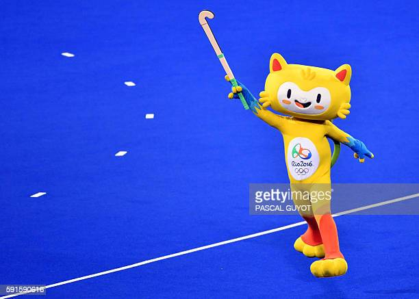 Vinicius the mascot of the Olympic games holds a stick on the pitch during the women's semifinal field hockey New Zealand vs Britain match of the Rio...
