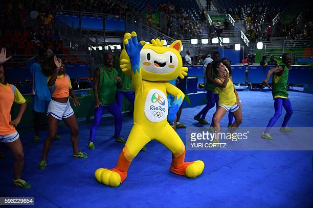 Vinicius the mascot of the Rio 2016 Olympic games dances ahead of the Women's Middle Final Bout at the Rio 2016 Olympic Games at the Riocentro...