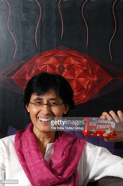 Vinita Bali CEO Britannia Industries poses with Tiger Biscuit Pack at office in Bangalore India Potrait Sitting