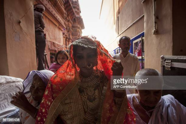Vinita Devi a former widow walks along other widows to meet her groom at Gopinath temple in the Vrindavan on October 16 2017 India has the greatest...