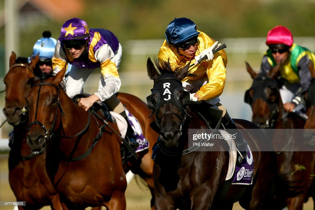 Vinnie Colgan riding Silent Achiever wins the Lindauer New Zealand Stakes during Diamond Day at the Ellerslie Racecourse on March 8 2014 in Auckland...