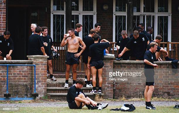 Vinnie Jones and Wimbledon team mates take a break after a pre season training session on July 27 1995 in Wimbledon England