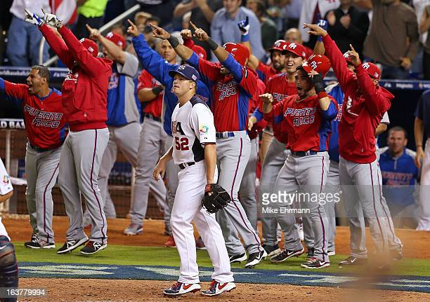 Vinnie Pestano of the United States looks on after giving up a two RBI double during a World Baseball Classic second round game against Puerto Rico...