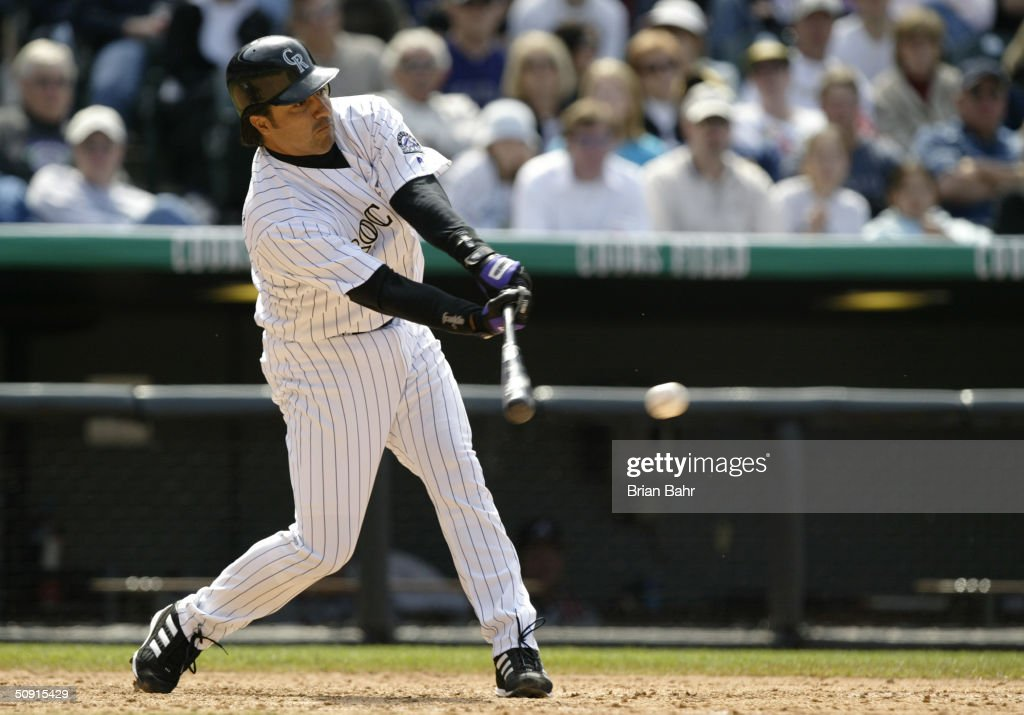 Vinny Castilla of the Colorado Rockies bats during the game against the Atlanta Braves in the first game of a doubleheader at Coors Field on May 1...