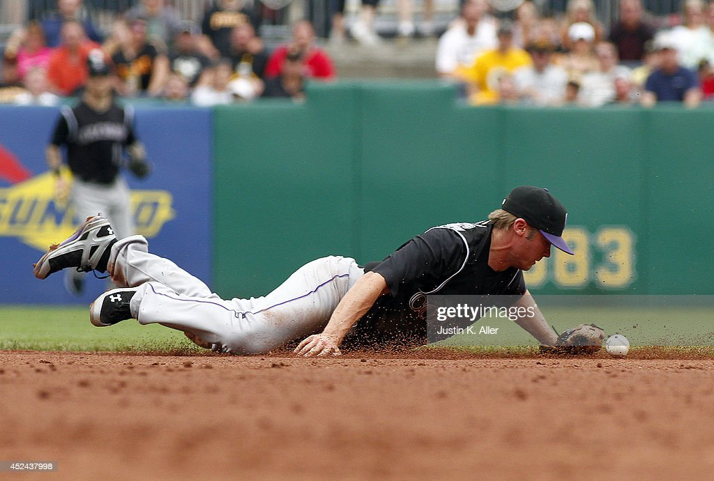 Vinny Castilla of the Colorado Rockies can't glove a ball in the third inning against the Pittsburgh Pirates during the game at PNC Park on July 20...