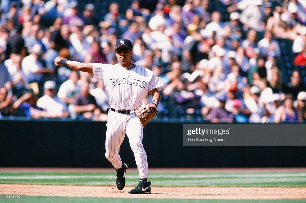Vinny Castilla of the Colorado Rockies fields against the Houston Astros at Coors Field on September 15 1996 in Denver Colorado The Rockies defeated...
