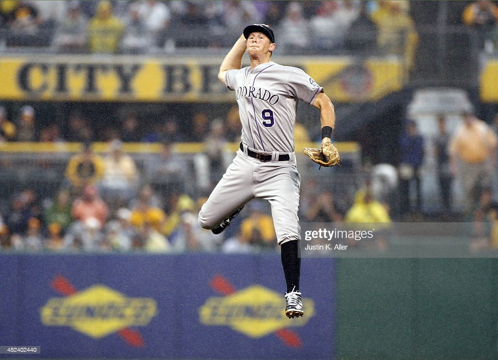 Vinny Castilla of the Colorado Rockies makes a throw from second base in the third inning against the Pittsburgh Pirates during the game at PNC Park...