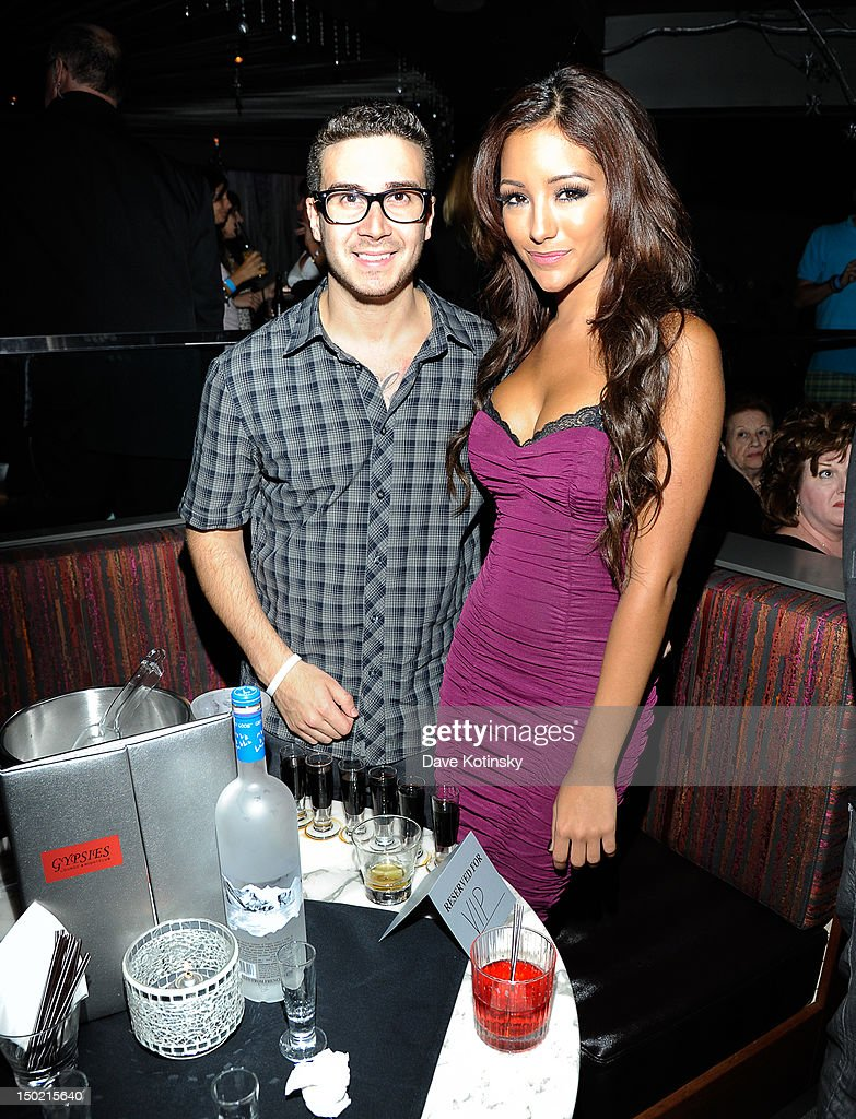 <a gi-track='captionPersonalityLinkClicked' href=/galleries/search?phrase=Vinny+Guadagnino&family=editorial&specificpeople=6693900 ng-click='$event.stopPropagation()'>Vinny Guadagnino</a> From Jersey Shore and girlfriend Melanie Iglesias hosts at Gypsies Lounge on August 12, 2012 in Mount Pocono, Pennsylvania.