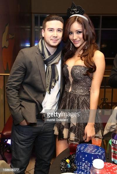 Vinny Guadagnino poses for photos with Melanie Iglesias during Joonbug's New Year's Eve 2013 Celebration With Vinny Guadagnino at AMC 34th Street on...