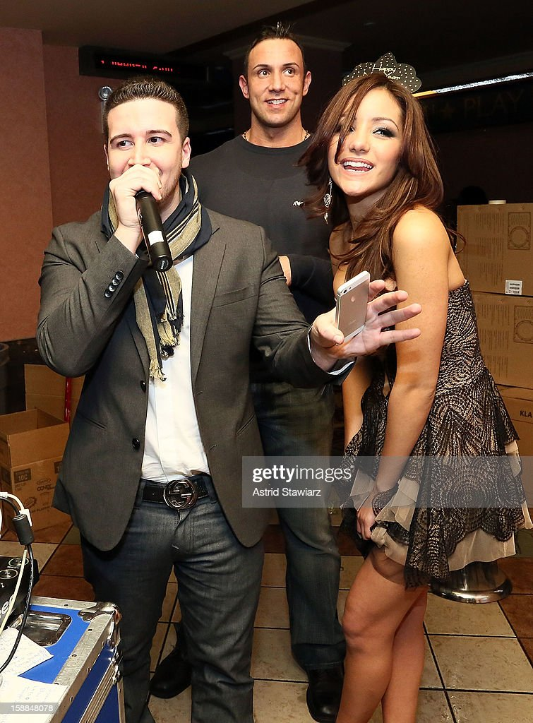 Vinny Guadagnino poses for photos with Melanie Iglesias during Joonbug's New Year's Eve 2013 Celebration With Vinny Guadagnino at AMC 34th Street on December 31, 2012 in New York City.