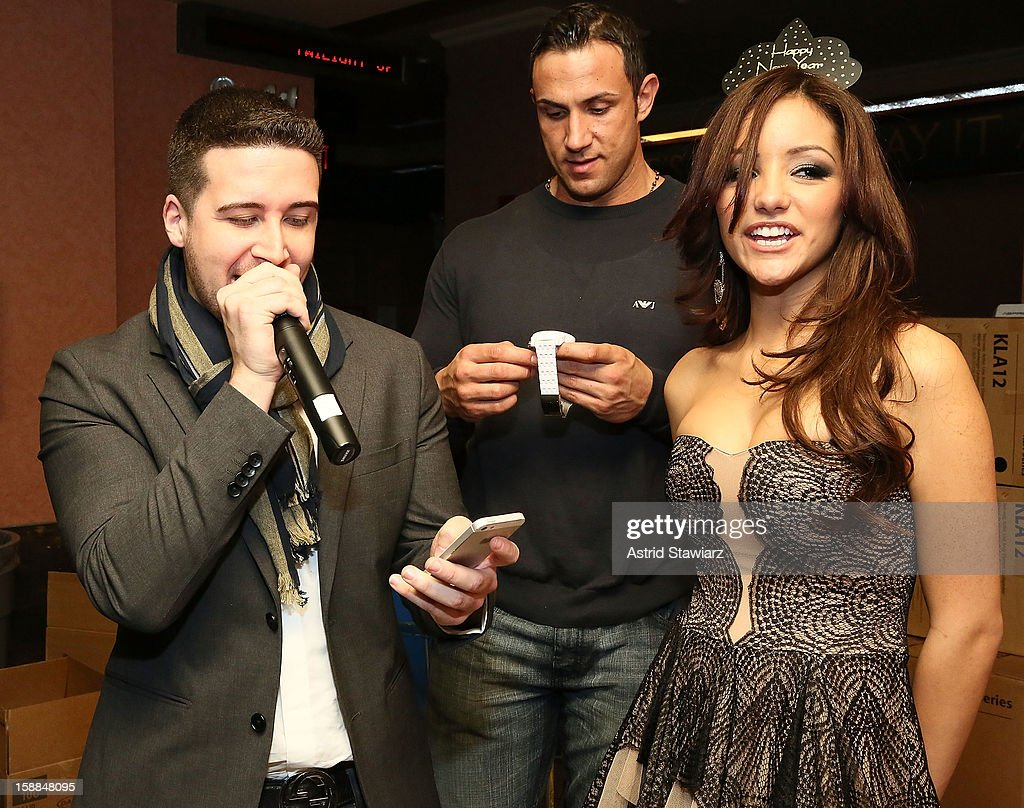 Vinny Guadagnino poses for photos with Melanie Iglesias during Joonbug's New Year's Eve 2013 Celebration With Vinny Guadagnino at AMC 34th Street on...